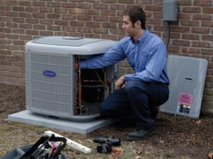 Clarkstown tech performing air conditioner tuneup