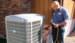 Clarkstown HVAC technician servicing unit