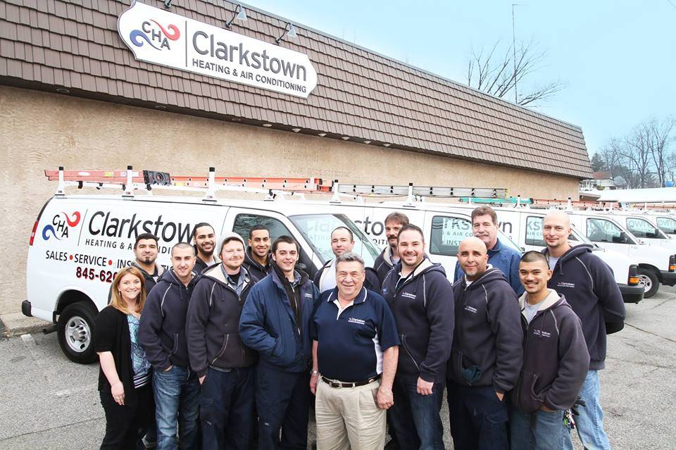 The clarkstown hvac team outside their building
