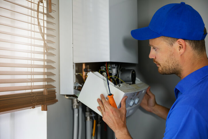 technician repairs hvac unit
