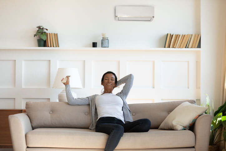 woman enjoys serviced air conditioning