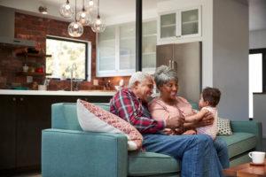 elderly couple with grandchild enjoying clean indoor air