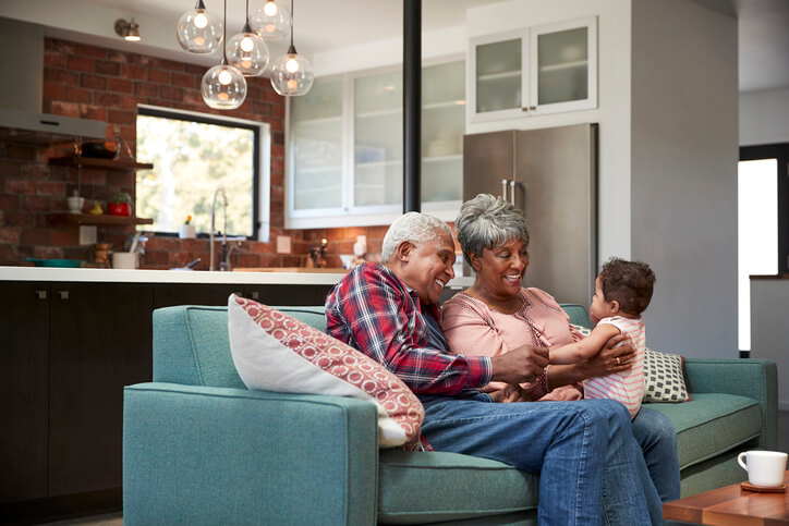 elderly couple with grandchild enjoying clean indoor air